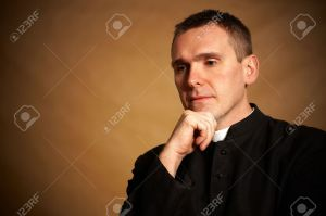 8887398-Thinking-priest-with-hand-under-chin-Stock-Photo-priest-pastor-catholic